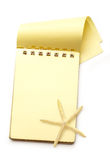 Yellow notepad with sea star Stock Photography