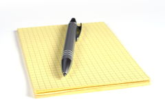 Yellow notepad and silver pen Royalty Free Stock Photography