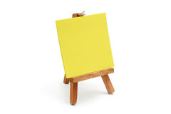 Yellow notepaper with mini easel Royalty Free Stock Photo
