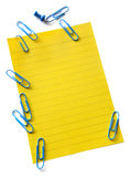 Yellow Notepaper with Paperclips Stock Images