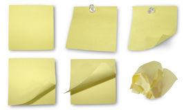 Yellow Notes Collection. Five different yellow sticky notes available. One is crinkled up into a ball. Two have tacks in them Royalty Free Stock Photos