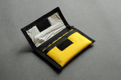 Yellow nylon purse. A yellow nylon purse on dark grey background Royalty Free Stock Photos