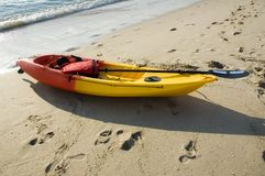 Yellow ocean kayak. A ocean kayak laying on a sandy beach in the early morning royalty free stock photography