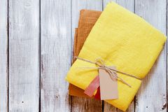 Yellow and ochre linen fabric packed with jute rope. Concept of sewing from natural textile clothing background. Place for text royalty free stock photos