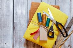 Yellow and ochre linen fabric packed with jute rope. Concept of sewing from natural textile clothing background. Place for text stock images