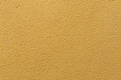 Yellow ochre painted stucco wall. Background texture.  Royalty Free Stock Photo