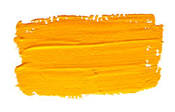 Yellow ochre strokes of the paint brush isolated Stock Photography