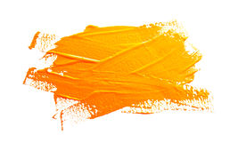 Yellow ochre strokes of the paint brush. On a white Royalty Free Stock Photo
