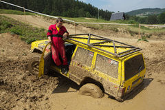 Yellow off road car drowned in muddy terrain Royalty Free Stock Photo