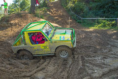 Yellow off road car in the mud terrain Royalty Free Stock Photo