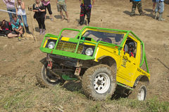 Yellow off-road car on a steep slope Stock Images