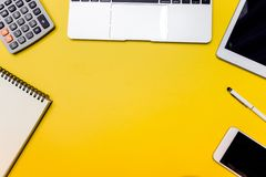Yellow office desk table with blank notebook. royalty free stock photography