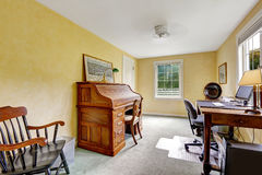Yellow office room interior with antique furniture Royalty Free Stock Photos