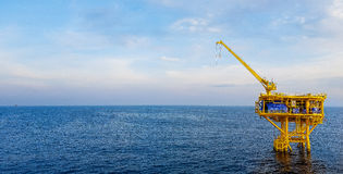 A yellow offshore oil drilling platform Stock Image