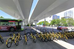 The yellow ofo shared bike under road bridge, adobe rgb. Shared bicycle is one of the four new inventions of china. it has gps and smart lock. user can rent it Stock Image