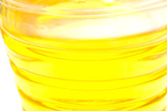 Yellow oil. Plastic bottle with yellow oil. A background, macro Royalty Free Stock Images