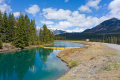 A yellow oil boom at banff national park Stock Images