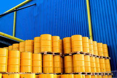Yellow oil drums and factory Royalty Free Stock Photo