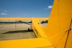 Yellow old airplane Stock Photos