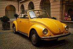 Yellow old Beatle VW in Munich royalty free stock image