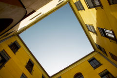 Yellow old building facade with blue sky Stock Image