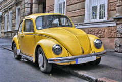 Yellow old car. On the street of small town Stock Image