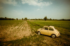Yellow old car in a field, Italy Royalty Free Stock Photos