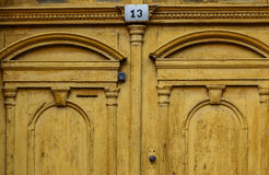 Yellow old door with number 13 Stock Photo