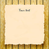 Yellow old paper with a sign on a wooden fence Royalty Free Stock Photos