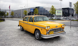 Yellow, old, vintage taxi car Stock Photo