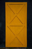 Yellow old wooden door Royalty Free Stock Image