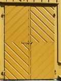 Yellow old wooden door, Lithuania Royalty Free Stock Photo