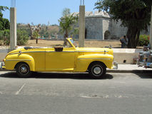 Yellow oldtimer. Classic american car in Havana streets Royalty Free Stock Photo