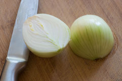 Yellow onion two half next to each other Royalty Free Stock Photography