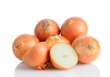 Yellow Onions on White With Reflection Stock Image