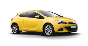 Yellow Opel Astra coupe isolated. Yellow coupe sport car side view isolated on white Stock Image