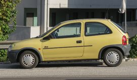Yellow Opel Corsa Viva. ROME, ITALY - CIRCA OCTOBER 2015: yellow Opel Corsa Viva car parked in a street of the city centre stock photo