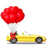 Yellow opened cartoon cabriolet car with bunch of red balloons. Yellow modern opened cartoon cabriolet car with bunch of red helium heart shaped balloons with Stock Images