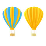 Yellow and orange air ballon with basket Royalty Free Stock Image
