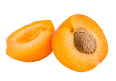 Yellow-orange apricots, half apricot with pip Royalty Free Stock Images