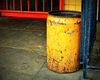 Yellow and orange. Beat up yellow can used as an ash tray is still beautiful Stock Image