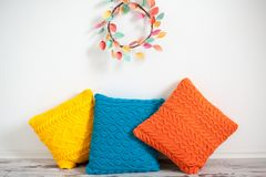 Yellow, orange and blue knitted cushions Royalty Free Stock Image