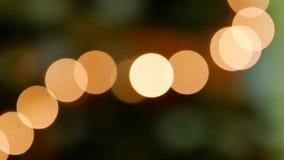 Yellow orange bokeh effect. Bokeh lights against a black background stock video footage
