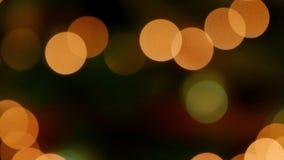 Yellow orange bokeh effect. Bokeh lights against a black background stock footage