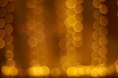 Yellow and orange bokeh of garland lights. Texture. christmas holiday background concept royalty free stock photo