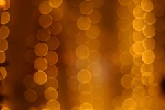 Yellow and orange bokeh of garland lights. Texture. christmas holiday background concept stock image
