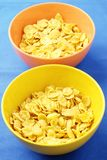 Yellow and orange bowls with corn Royalty Free Stock Photography