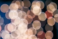 Yellow and orange Christmas tree bokeh on black background of defocused glittering lights, Christmas background pattern concept stock image
