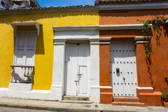 Yellow and Orange Colonial Architecture Stock Images