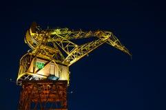 Yellow and Orange Crane. A yellow and orange crane seen at night Stock Photos